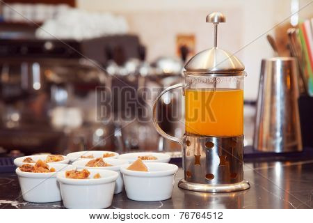 tea in a French-press with sweets