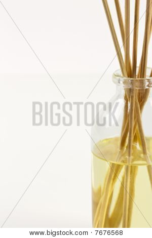 Aromatherapy Oils In A Glass Jar With Bamboo Sticks