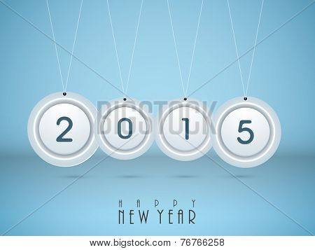 Stylish hanging sticker, tag or label with text 2015 on shiny blue background for Happy New Year celebrations.
