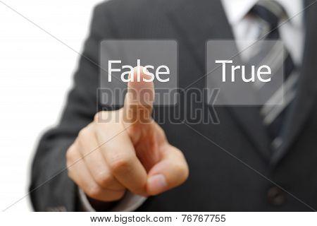 Businessman Choose Virtual Button With False Word Instead True