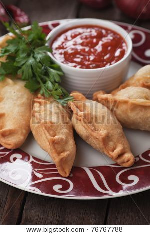 Fried empanadas, popular Latin American food served as snack or appetizer