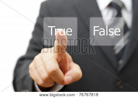Businessman Choose Virtual Button With True Word Instead False