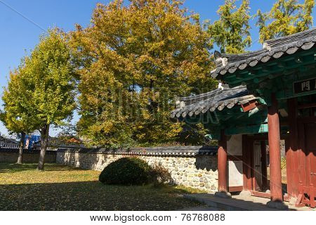 traditional walled Korean village homes with garden and parks, in autumn colors