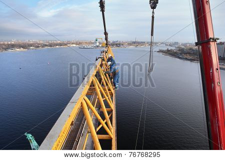 Installation Of Tower Crane On Construction Site, Workers Steeplejacks Working.