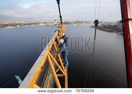 Installers Working Jib Fixed To The Mast Of Tower Crane.