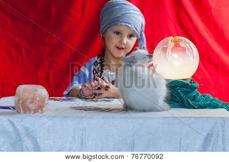 Child Fortune Teller With Her Cat
