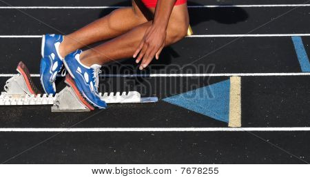 Teen Boy Leaving The Starting Blocks