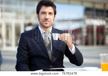 Portrait of a businessman drinking a coffee