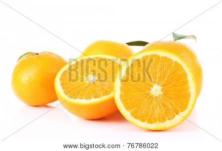 Ripe tangerines and oranges with leaves isolated on white