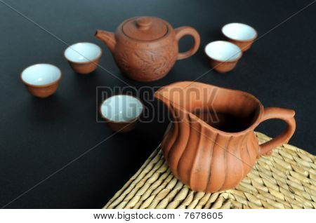 Old clay pot and tea-set