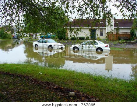 Cars on a side street after a flood,