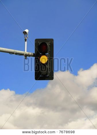 Yellow Traffic Light And Camera.