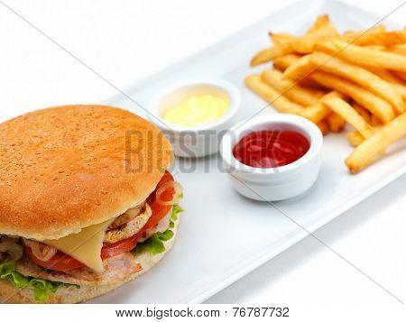 still life with fast food hamburger menu, french fries and ketchup