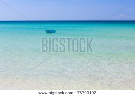 Fisher boat and clear turquoise water