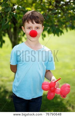 Little Boy With Red Clown Nose