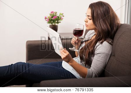Taking A Sip Of Wine