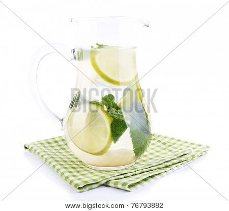 Lemonade in pitcher isolated on white