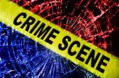 picture of crime scene  - Broken window with yellow Crime Scene tape - JPG