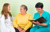 stock photo of interrogation  - Photo of elderly woman interrogated by the doctor - JPG