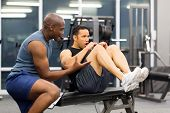 stock photo of personal trainer  - fit middle aged man with personal trainer in gym - JPG