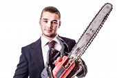 image of man chainsaw  - a young businessman holding a red chainsaw isolated over a white background - JPG