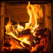 pic of furnace  - fire in the brick furnace close up - JPG