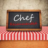 image of recommendation  - Chef Recommended Title in white chalk on Restaurant Blackboard - JPG