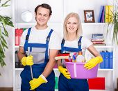 picture of cleaning house  - Young smiling couple are holding cleaning tools - JPG