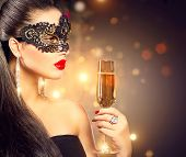 pic of masquerade mask  - Sexy model woman with glass of champagne wearing venetian masquerade mask at party - JPG