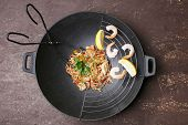 stock photo of chinese wok  - Chinese noodles with vegetables and seafood in wok - JPG