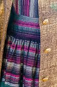 pic of overcoats  - Detail of handmade colorful dress and overcoat - JPG