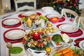 stock photo of christmas meal  - Table set for christmas dinner at home in the living room - JPG
