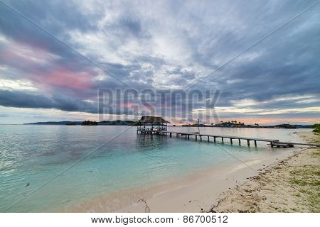 Seascape And Cloudscape With Jetty At Dusk