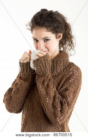 Brunette In Knitted Pullver Drinking From A Mug