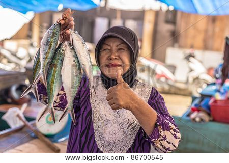 Woman Selling Fishes In Local Market