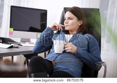 Businesswoman Sitting Pondering