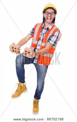 Funny young construction worker with broken brick isolated on white