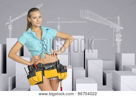 Girl in tool belt standing akimbo. Minimalistic city with tower cranes