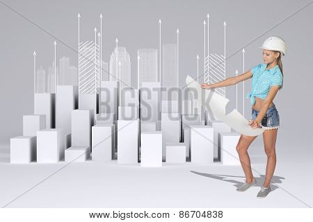 Beautiful girl looking at empty paper sheet. Minimalistic city with buildings