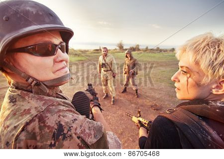 Military Patrol (man And Blond Woman) Is Stopping Two Rebels On The Road