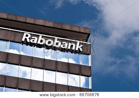 Modern building with Rabobank logo against blue sky with clouds