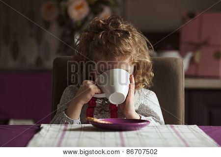 Little Girl Drinks Tea