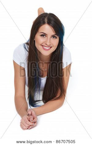 Smiling beautiful woman lying on the floor