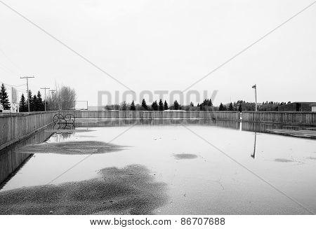 Pool of water in outdoor skating rink