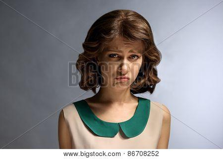 Portrait of beautiful model on gray background