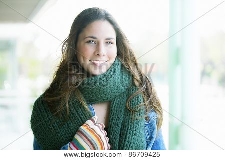 Beautifull brunette dressed with winter warm clothing