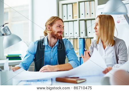 Pretty businesswoman explaining to colleague her ideas about new project