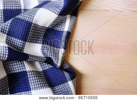 Kitchen towel on wooden background