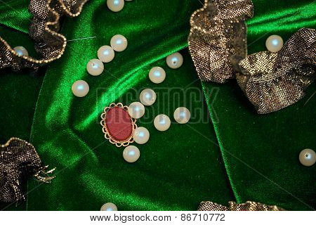 Pearls and edging on fabric background