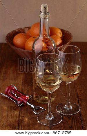 Wineglasses, Bottle And Orange Fruits